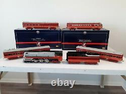 Lionel standard gauge Hiawatha loco and tender with 4 passenger cars in box